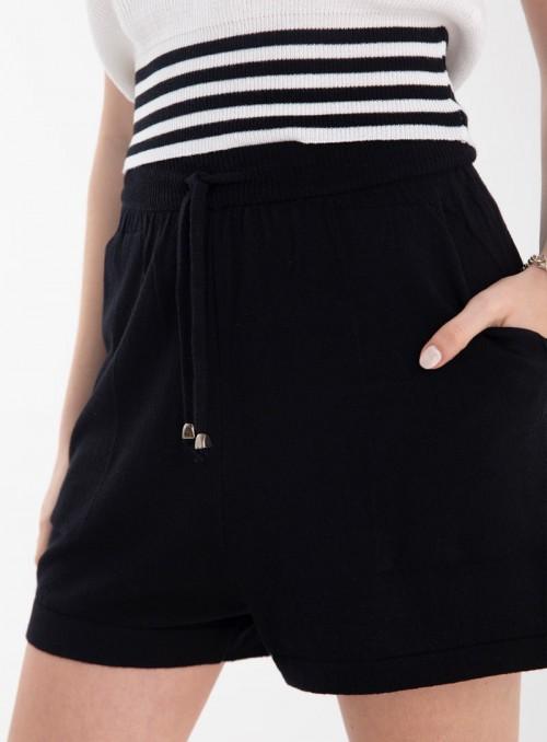 Shorts  con bolsillo de...